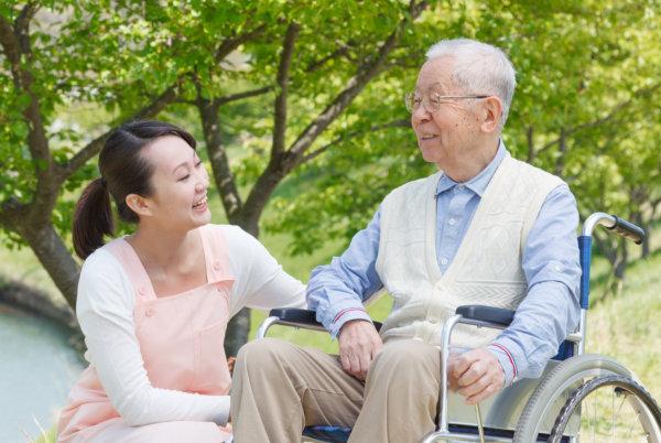 elder man with his caregiver